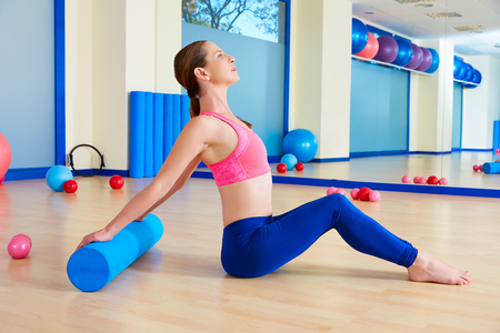 stretches: Pilates woman roller exercise workout at gym indoor