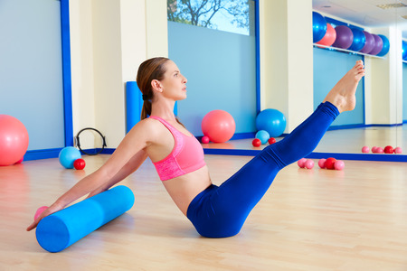Pilates woman roller teaser roll exercise workout at gym indoor 스톡 콘텐츠