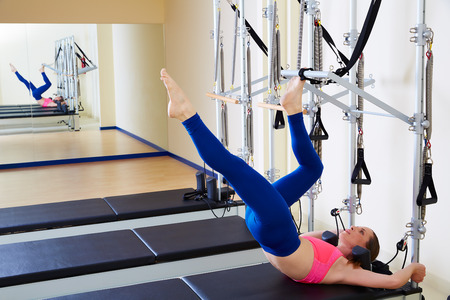 Pilates reformer woman tower exercise workout at gym indoor Stock Photo