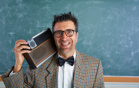 Radio: Nerd silly retro teacher man with braces and vintage radio and crazy expression Stock Photo