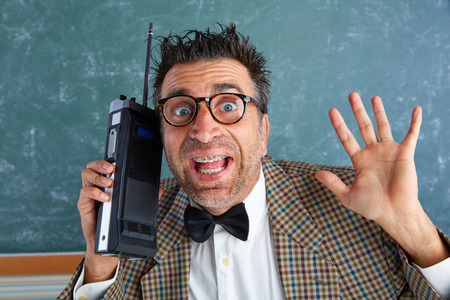 walkie talkie: Nerd silly private investigator with retro walkie talkie on teacher balckboard