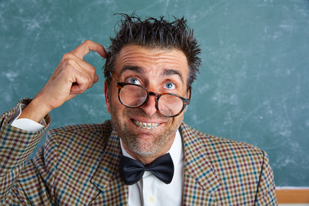 myopic: Nerd silly retro teacher man with braces funny thinking doubt expression