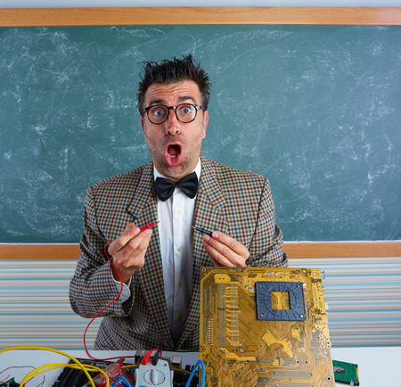 pcb: Nerd electronics technician retro teacher silly expression working in pcb