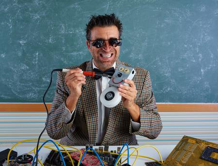 tacky: Nerd electronics technician silly retro teacher welding self made robot