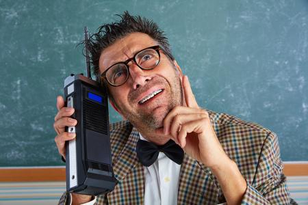 talkie: Nerd silly private investigator with retro walkie talkie on teacher balckboard