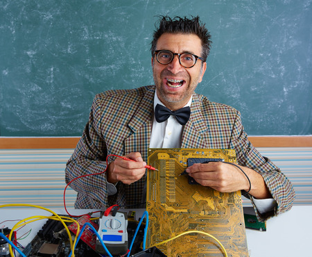unfashionable: Nerd electronics technician retro teacher silly expression working in pcb