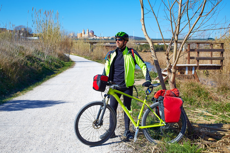 saddlebag: cycling tourist MTB cyclist in Ribarroja Parc de Turia with paniers and saddlebag