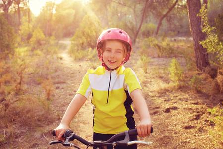 mtb: kid girl biker in mountain bike MTB at mediterranean forest Stock Photo