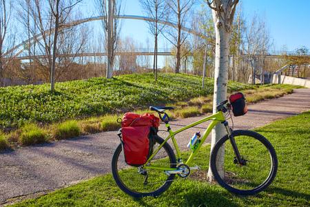 touring: MTB Bicycle touring bike in Valencia Cabecera park bridge gardens