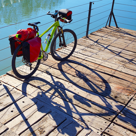 touring: MTB Bicycle touring bike in a park with pannier racks and saddlebag
