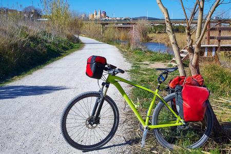 saddlebag: cycling tourism MTB bike in Ribarroja Parc de Turia with paniers and saddlebag Stock Photo