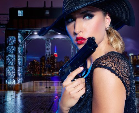 gangster girl: Blond sexy girl with handgun pistol gangster style in New York Photomount