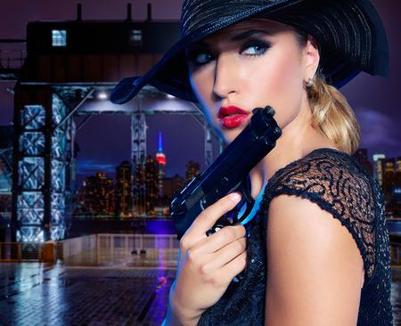 gangster girl: Blond sexy girl with handgun pistol gangster style in New York Photomount