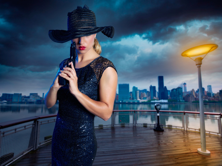 modern girl: Blond sexy girl with handgun pistol gangster style in New York Photomount