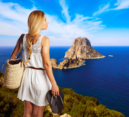 es: young tourist girl in formentera with es vedra