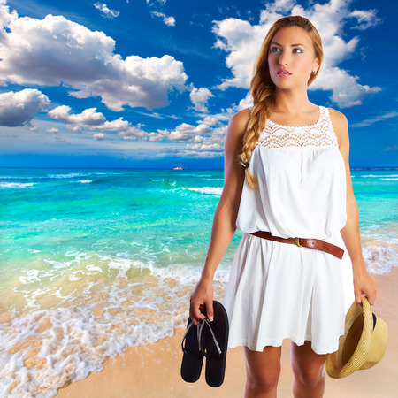 Blond tourist girl in Es Trenc beach of Mallorca photomount photo
