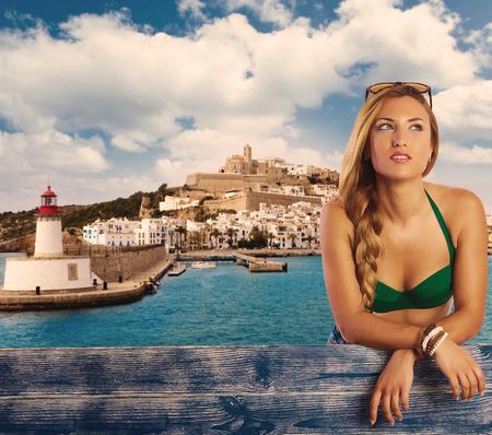 Blond girl tourist in Ibiza skyline summer top photomount photo