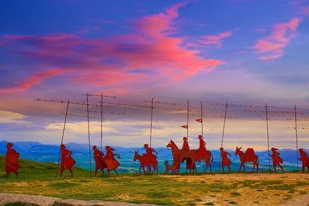 camino de santiago: The way of Saint James Alto del Perdon top with steel sculpture of pilgrims at Navarra Stock Photo