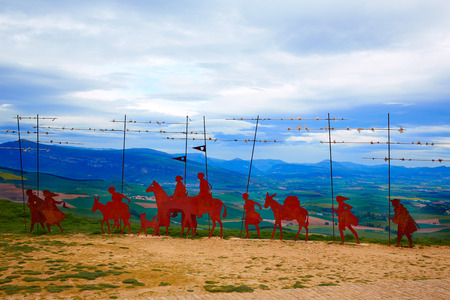 xacobeo: The way of Saint James Alto del Perdon top with steel sculpture of pilgrims at Navarra Stock Photo