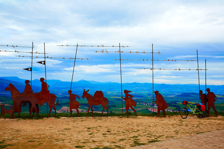 xacobeo: The way of Saint James Alto del Perdon top with steel sculpture of pilgrims at Navarra and bike Stock Photo