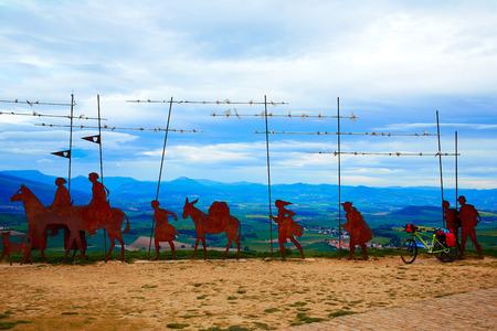 navarra: The way of Saint James Alto del Perdon top with steel sculpture of pilgrims at Navarra and bike Stock Photo