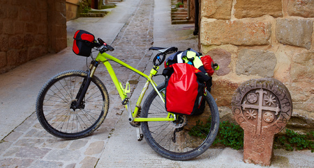 pilgrim journey: The way of Saint James stone sign in Cirauqui with bike Pamplona Spain Stock Photo