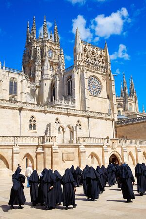 nuns: Burgos Cathedral facade in Saint James Way with unknown nuns at Castilla Leon of Spain Stock Photo