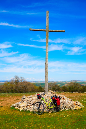 the french way: Cruz de Atapuerca cross biking in Saint James Way Castilla near Burgos Stock Photo