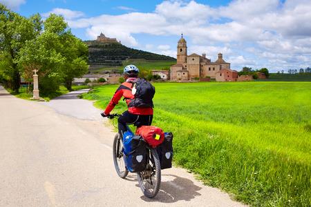 pilgrim journey: Castrojeriz biker on the way of Saint James at Castilla Spain