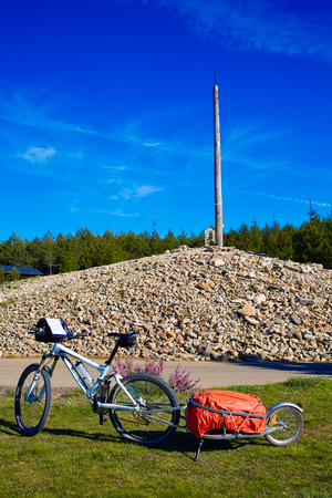 pilgrim journey: Cruz de Ferro top at Saint James Way bikes Leon Spain