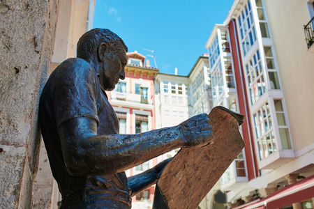 xacobeo: Burgos statue or the newspaper reader next to Plaza Mayor square in Castilla Spain Stock Photo