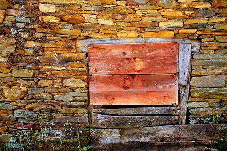 pilgrim journey: Way of Saint James slate stone wooden door in Galicia Spain