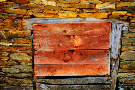 xacobeo: Way of Saint James slate stone wooden door in Galicia Spain