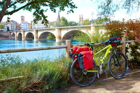 the french way: The Way of Saint James biking in Logrono bridge Ebro river at Spain