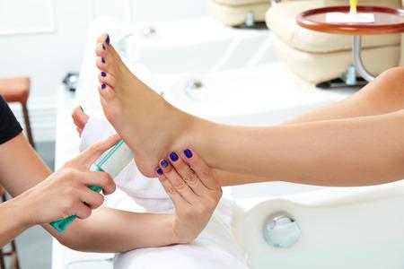 nail color: Pedicure dead skin remover foot rasp woman in nail salon