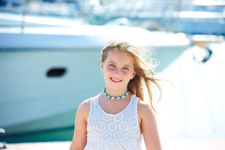 Blond kid teen girl in Mediterranean port of Spain