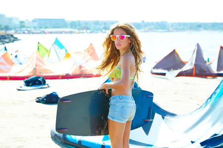 teen beach: Blond kite surf teen girl in summer beach at Mediterranean Stock Photo