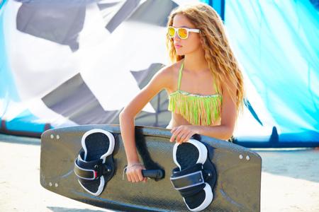 Blond kite surf teen girl in summer beach at Mediterranean Stock Photo