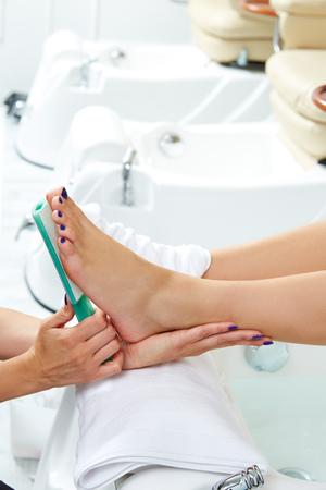 remover: Pedicure dead skin remover foot rasp woman in nail salon