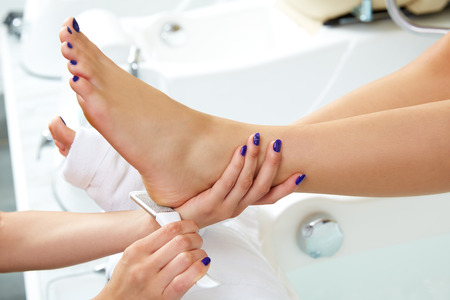 Pedicure dead skin remover foot rasp woman in nail salon