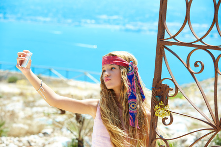 costa blanca: Blond girl selfie photo in mediterranean sea gate at Spain Stock Photo
