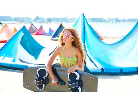 kite: Blond kite surf teen girl in summer beach at Mediterranean Stock Photo