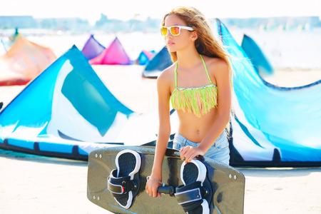 curly hair child: Blond kite surf teen girl in summer beach at Mediterranean Stock Photo