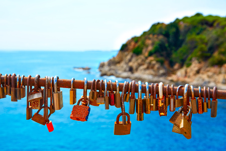 costa brava: Costa Brava beach Lloret de Mar padlocks in a row Catalonia at Spain