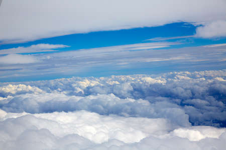 aircraft: Aerial view of clouds and blue sky while flying on aircraft