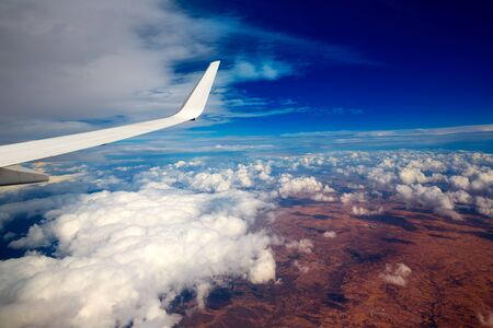 planes: Aircraft wing in a cloudy stormy clouds sky flying