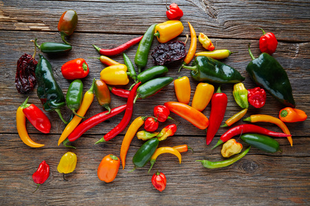 piquancy: Mexican hot chili peppers colorful mix habanero poblano serrano jalapeno on wood