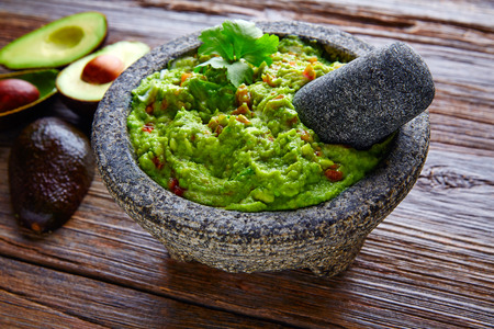 lunch meal: avocado Guacamole on molcajete real Mexican traditional procedure