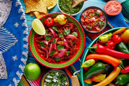 piquancy: Cochinita Pibil Mexican platillo food with red onion and coriander Stock Photo