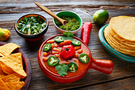 piquancy: Frijoles charros mexican beans with chili pepper sides and tortillas